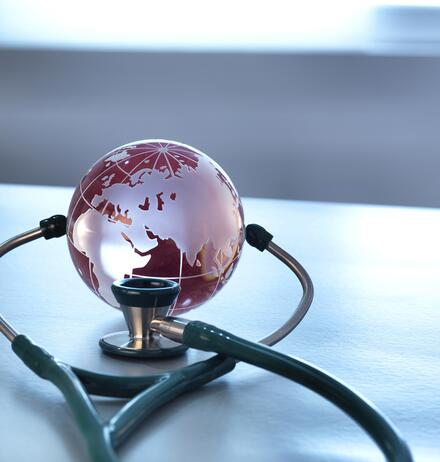 Stethoscope with globe paper weight