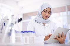 Woman looking at report in laboratory