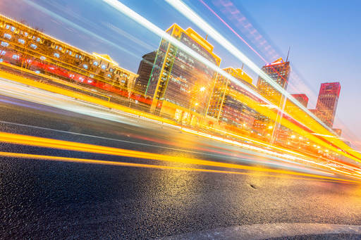 Blurred city traffic with yellow streaks