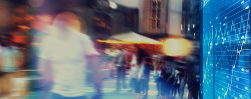 Blurred people walking near digital screen