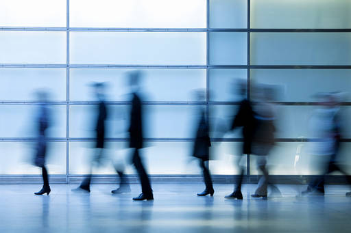 Business people walking in subway station