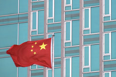 China flag with building in background