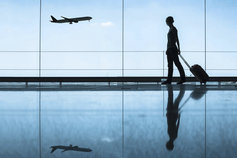 Silhouette of woman traveller looking at plane