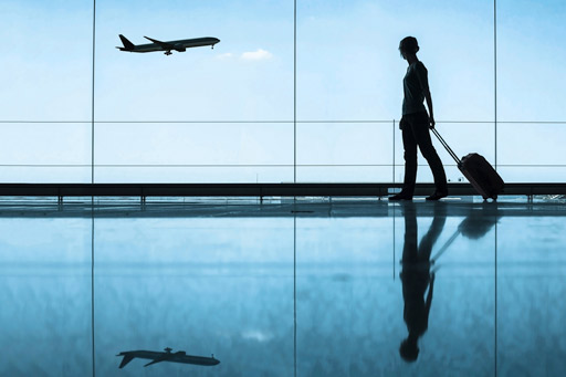 Silhouette of traveller looking at plane