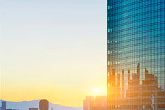 Tall building with reflective glass at sunrise