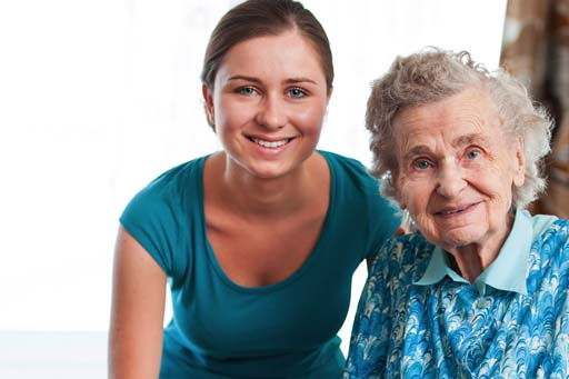 A senior woman being assisted by a young carer