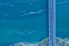 Aerial view of bridge over water with blue overlay