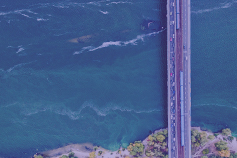 Aerial view of bridge over water with violet overlay