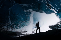 Explorer in ice cave