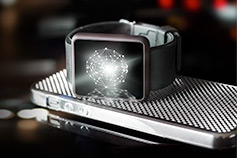 Smart watch sitting on top of phone