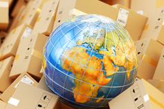 Globe sitting on shipping boxes
