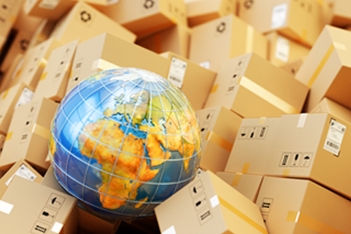 A globe resting on cardboard boxes