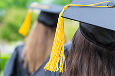 Graduates wearing mortarboards at graduation ceremony