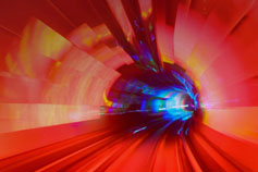 Illuminated train tunnel in orange and red