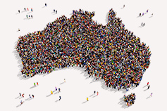 Large group of people forming a shape of Australia