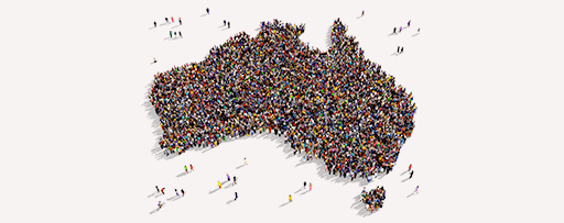 Large group of people gathered together forming a map of Australia