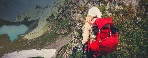 Mountain hiker with red backpack