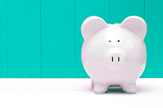 Piggy bank on a teal background