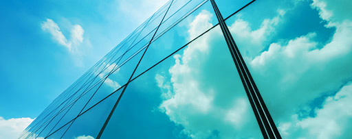 Skyscraper window reflecting sky and clouds