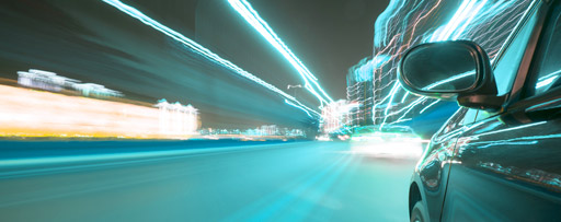 Speeding car with light trails