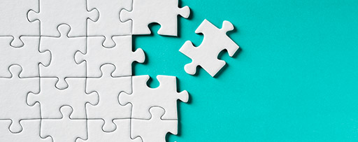 White Jigsaw Puzzle on teal background