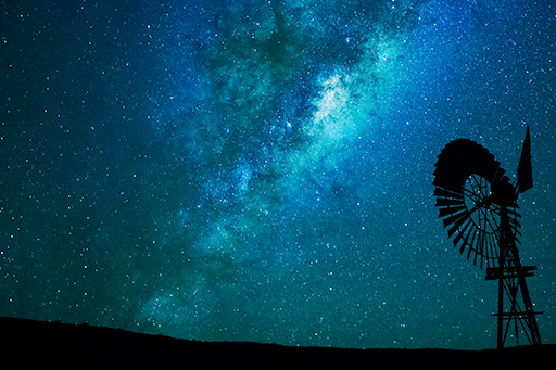 Windmill at night with stars in the sky