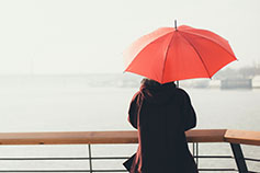 Woman holding red umbrella