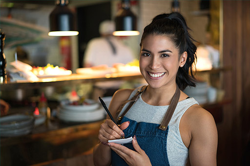 Young waitress working at a coffee shop