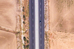 Aerial view of highway near a salt lake