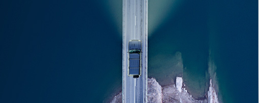 Aerial view of a road above a lake