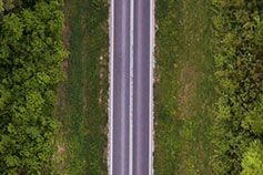 Aerial view of a road through a forest