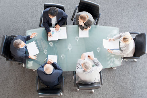 Business people conducting a meeting around a table