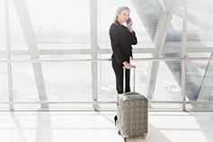 Business traveller on a smart phone at the airport