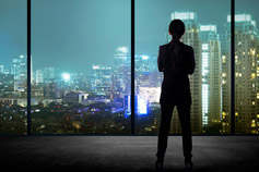 Businessman looking out his office window