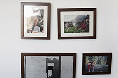 Framed family photos on a wall