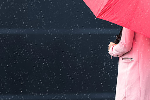 Girl holding a red umbrella on a rainy day