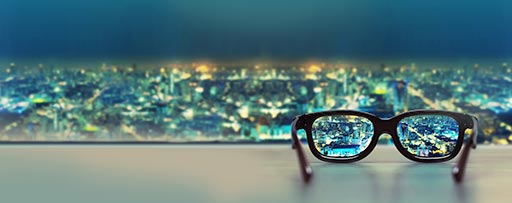 Glasses focused on city skyline