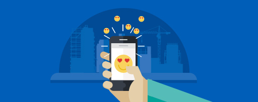 Hand holding smartphone with heart eyed emojis illustration