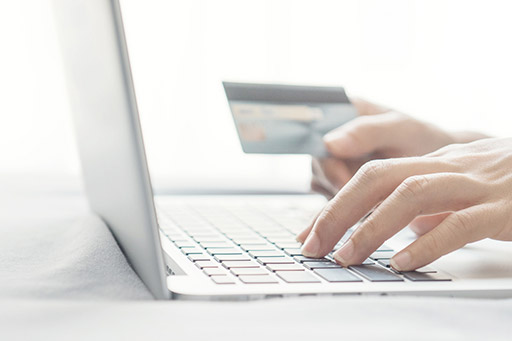 User with laptop and credit card