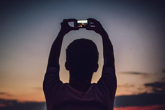 Man taking photo at dusk