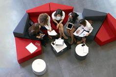 Employees meeting in an office lobby