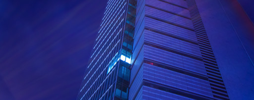 Single illuminated window in a high-rise office building