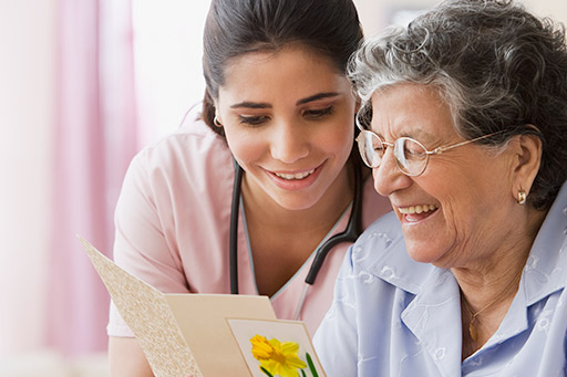 A nurse assisting an elderly person