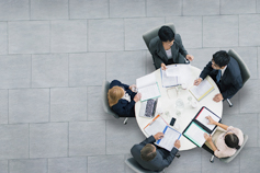 Elevated view of a business meeting at a round table