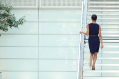 Businesswoman going up stairs in office
