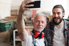 Father and son carpenters taking a selfie