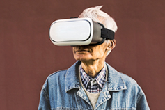 Hipster grandpa wearing virtual reality glasses
