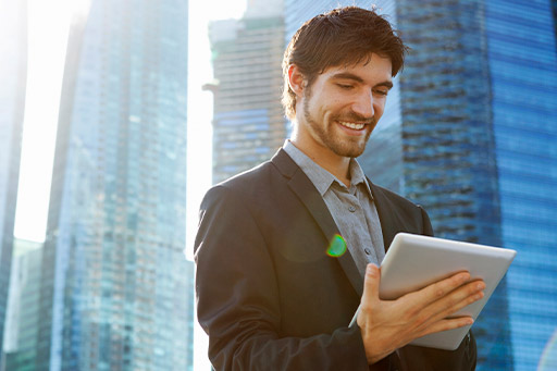 Modern business man in city with digital tablet
