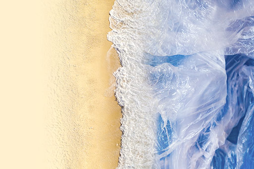 Aerial view of beach with plastic bag instead of water