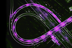 Aerial view of a highway with purple streaks